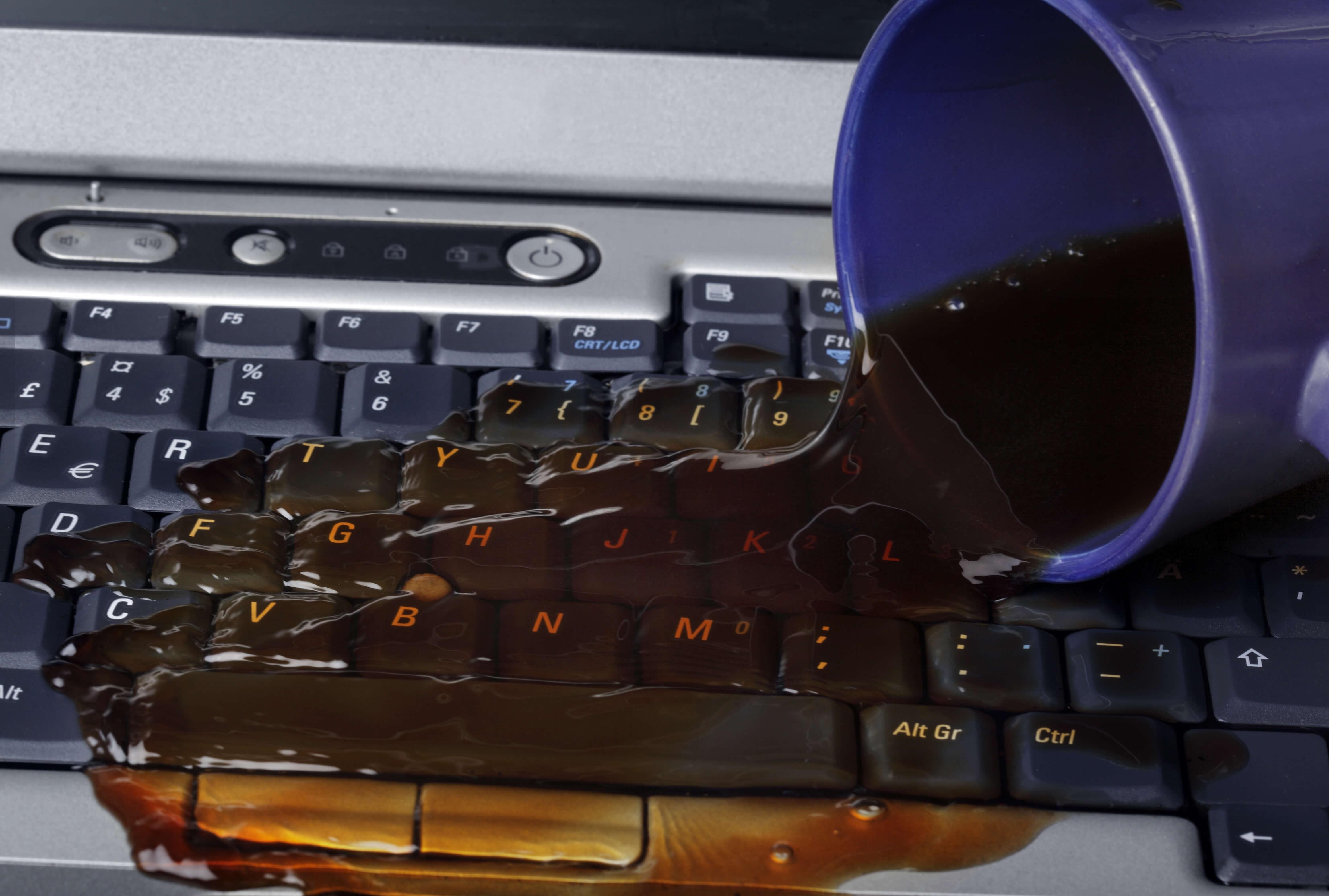 laptop liquid spill repair Australia Melbourne